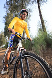 Young man riding mountain bike mtb in jungle track use for sport. Extreme adventure healthy and holiday activities life style Stock Image