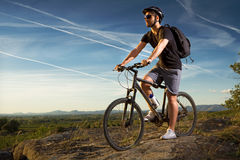 Young man riding mountain bike Stock Photography