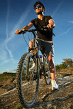 Young man riding mountain bike Royalty Free Stock Images
