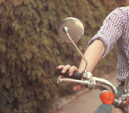 Young man riding old retro scooter Royalty Free Stock Image