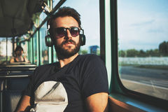 Young man riding in public transport Stock Photo
