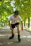 Young man riding roller skates Royalty Free Stock Images