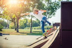 Young man riding skate at park and falling down Stock Photography