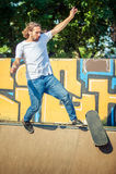Young man riding skate at park and falling down Royalty Free Stock Photo