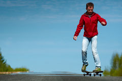 Young man riding the skateboard Royalty Free Stock Image