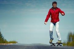 Young man riding the skateboard Stock Photo