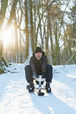 Young man riding a snow scooter Stock Photo