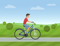 Young man riding a sport bike on a park road. Vector illustration. Male bicycle Royalty Free Stock Photography