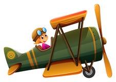 A young man riding on a vintage plane Stock Photos