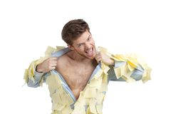 A young man ripping off his shirt Royalty Free Stock Photo