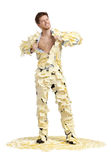 A young man ripping off his shirt, covered with stickers, full-length portrait Royalty Free Stock Images
