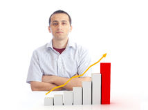 Young man with a rising chart Stock Image