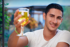 Young Man Rising a Glass in a Bar Royalty Free Stock Photo