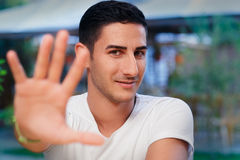 Young Man Rising Hand Making Stop Gesture Royalty Free Stock Images