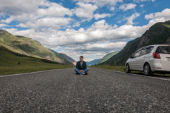 Young man road mountains car Stock Image