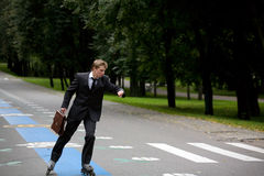 Young Man On The Road With Rollerblades royalty free stock image