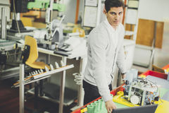 Young man in robotics classroom. Young man working in the robotics classroom Royalty Free Stock Photos