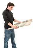 Young man with roll of blueprints Stock Photo