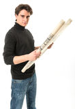 Young man with roll of blueprints Stock Photography