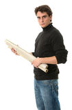 Young man with roll of blueprints Royalty Free Stock Image