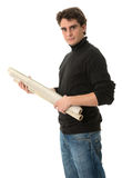 Young man with roll of blueprints Stock Photos