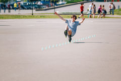 Young man roller on rollerblades driving in park Stock Image