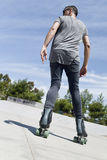 Young man roller skating Stock Images