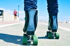 Young man roller skating Stock Photos