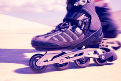 Young man roller skating, filtered Stock Photo