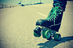 Young man roller skating, with a retro effect Royalty Free Stock Photography
