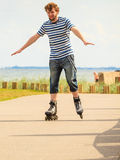 Young man rollerblading outdoor on sunny day Royalty Free Stock Image