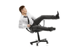 Young man rolling on chiar Stock Photo