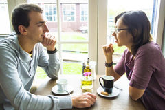 Young man on romantic date with his sweetheart in cafe. Young men on romantic date with his sweetheart in a cafe Royalty Free Stock Photography