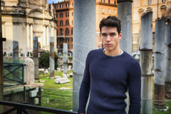 Young man in Rome standing in front of Foro Traiano and Fori Imperiali Stock Photography