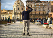Young man in Rome standing in front of Santa Maria di Loreto church Royalty Free Stock Image