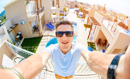 Young man on the roof of the house Stock Images