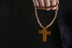Young man with a rosary in his hand Stock Images
