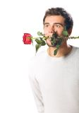 Young man with rose Stock Images