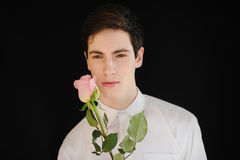 Young man with a rose Stock Photography