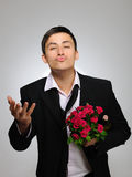 Young man with rose flower and vine bottle Stock Photography