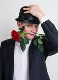 A young man with a rose Royalty Free Stock Image