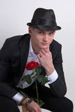 A young man with a rose. Stock Photos