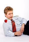 Young man with rose in teeth Stock Images