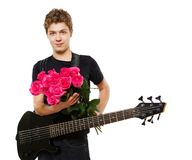 Young man with roses Royalty Free Stock Photography