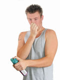 Young Man Rotten Smell. Young man smells something bad stock photo
