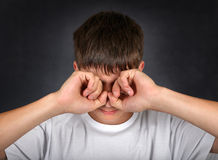 Young Man Rub his Eyes Royalty Free Stock Photography
