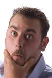 Young man rubbing chin Stock Photos