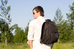 Young man with rucksack outdoor Stock Images