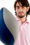 Young man with rugby ball Stock Photo