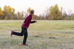 Young man run in the field in national park f stock image